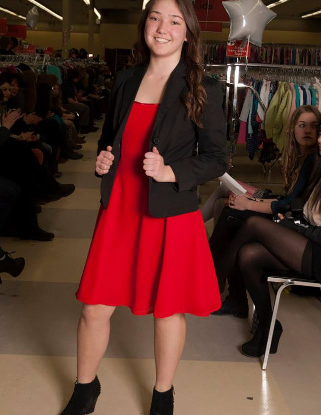 Grace Ottenhof contrasts a red dress with a black blazer and pairs the outfit with a pair of suede black wedges. Photo credit: Camille Prior.