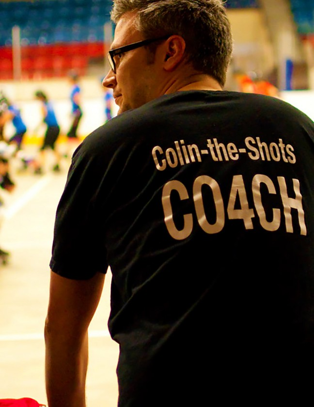 """The Skateful Dead Coach """"Colin-the-Shots"""" looks on while the Kingston Derby Girls scrimmage during practice."""