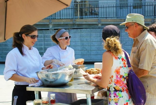 Grace Genter from Atomica serving up some hungry demo attendees. (photo by Julia Segal)