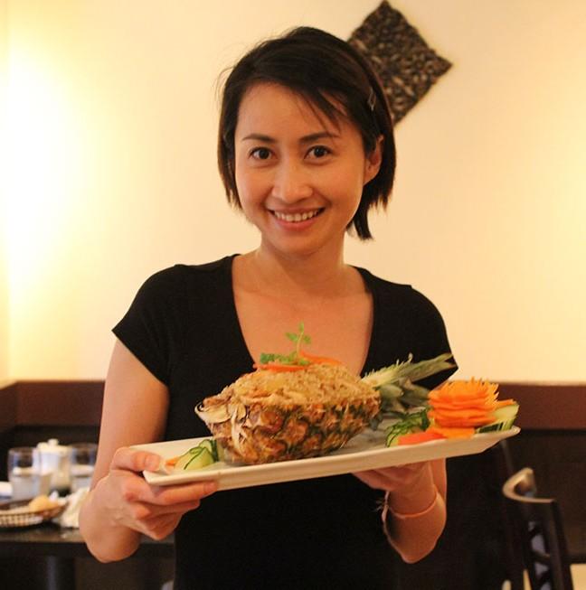 Nattiya with a customer favourite: Pineapple Fried Rice