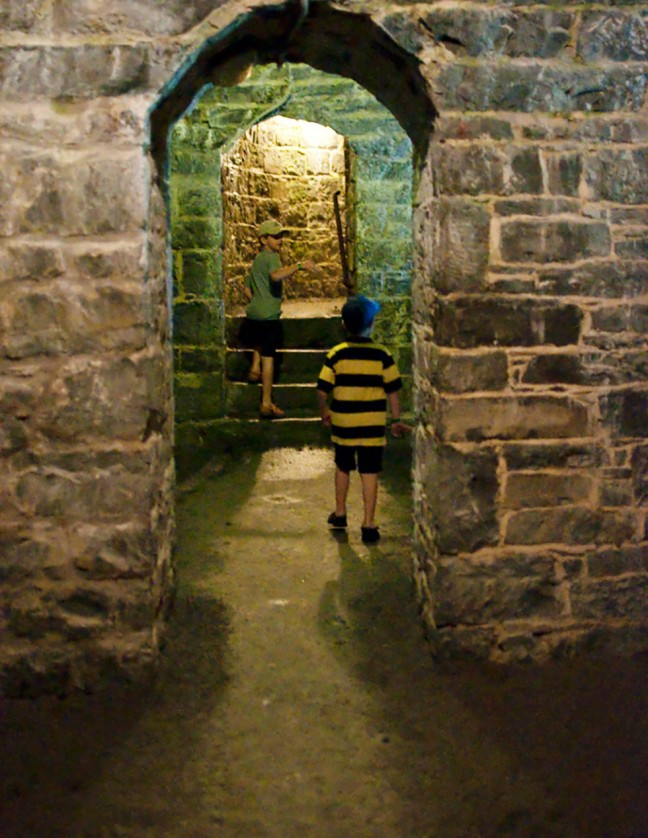 Will and Tom pretending to be members of the Fort Henry Guard as they explore the secret passages of the Fort.