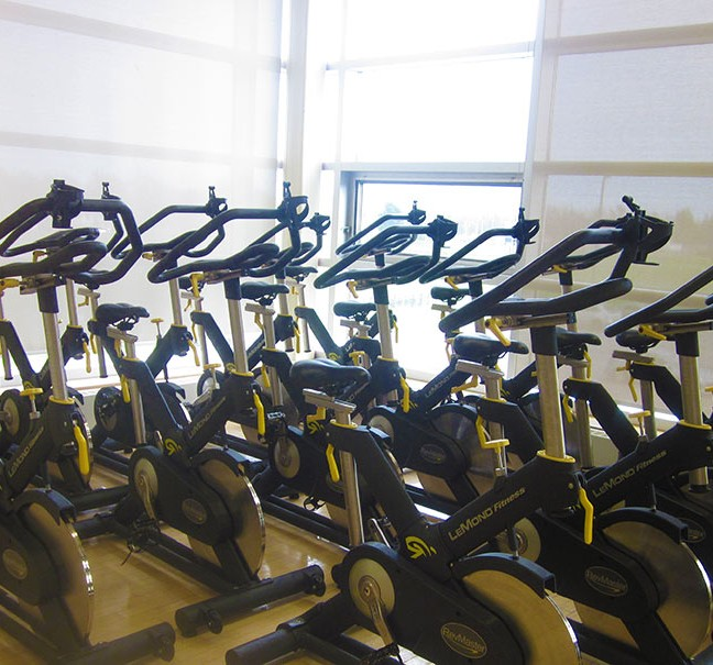 The upper gym at St. Lawrence is also used for spinning classes and offers a great view of King Street and Lake Ontario Park from its wall of windows.