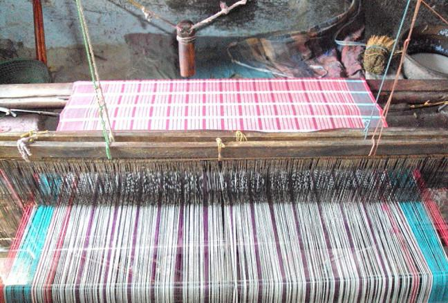 Handlooms are used over the world for making fabric, though only a few loom artisans remain in the world today. © Amartyabag
