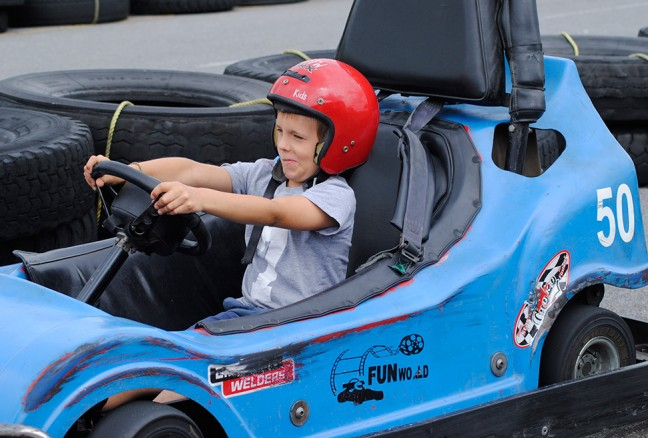 Iain trying out a single car….too short! Can't reach the pedals.