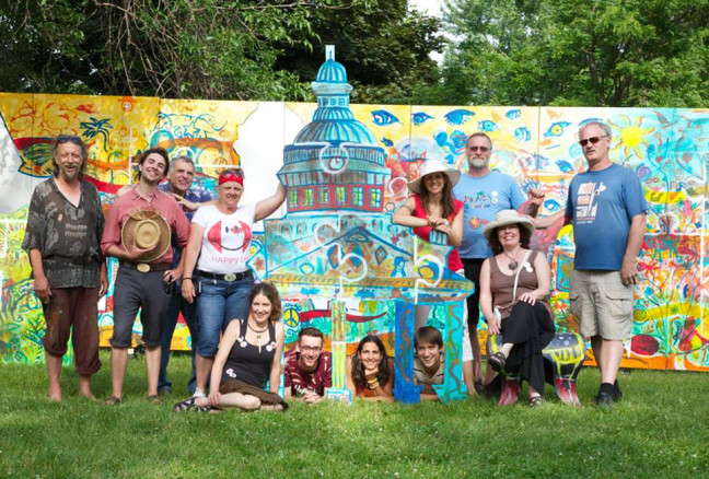 A few of last year's artists, including Lory MacDonald (seated), the show producer. (Photo: Artfest Kingston)