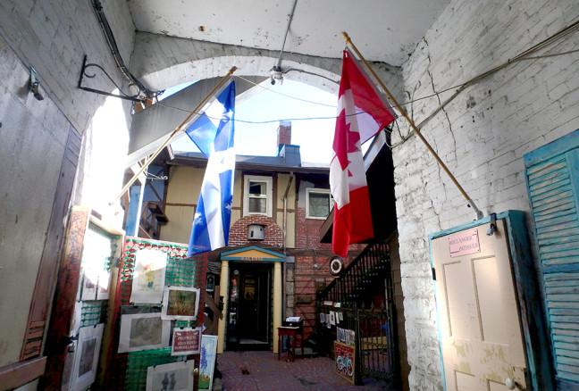 A Quebecois flag flies next to the Canadian one, recalling its inspiration from rue du Trésor in Quebec City.