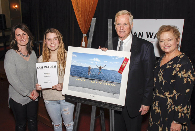 Paige Palmer, second from left, is awarded $700 and has her photo taken with Kingston Life's editor Danielle Vandenbrink, and Kingston Accommodation Partners representatives William J Swan and Heather Ford, after her photo was chosen as the overall winner in the Student and Youth Category at the inaugural Ian Walsh Photography Competition award ceremony held in Memorial Hall in Kingston, Ont. on Wednesday February 10, 2016. Julia McKay/The Whig-Standard/Postmedia Network