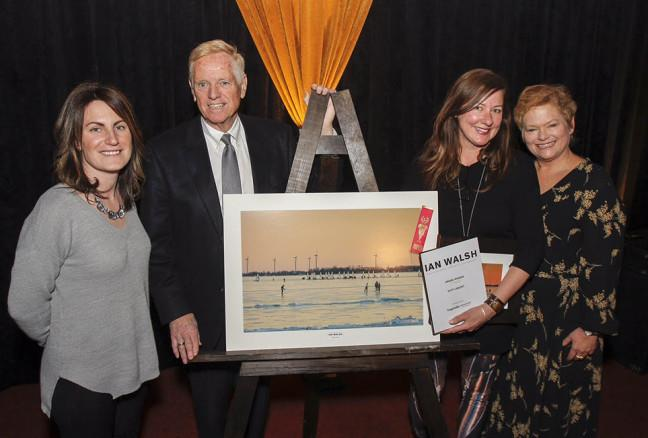 Suzy Lamont, second from right, is awarded $2,500 and has her photo taken with Kingston Life's editor Danielle Vandenbrink, and Kingston Accommodation Partners representatives William J Swan and Heather Ford, after her photo was chosen as the overall winner in the Open Category at the inaugural Ian Walsh Photography Competition award ceremony held in Memorial Hall in Kingston, Ont. on Wednesday February 10, 2016. Julia McKay/The Whig-Standard/Postmedia Network