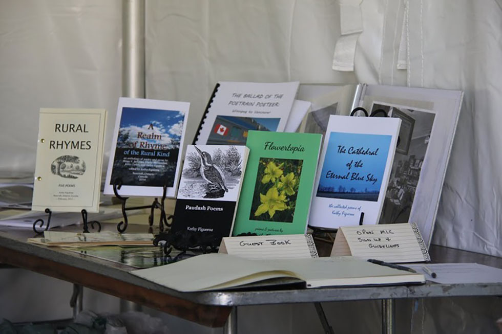 Buy some poetry books at the Poets @ Artfest Tent!