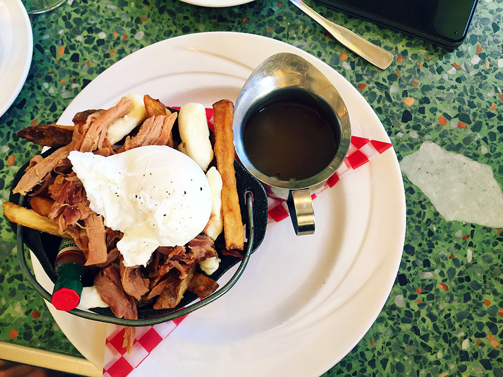 """Pan Chancho-breakfast poutine –smoked ham, cheese curds, poached egg drowned in """"red-eye"""" gravy."""
