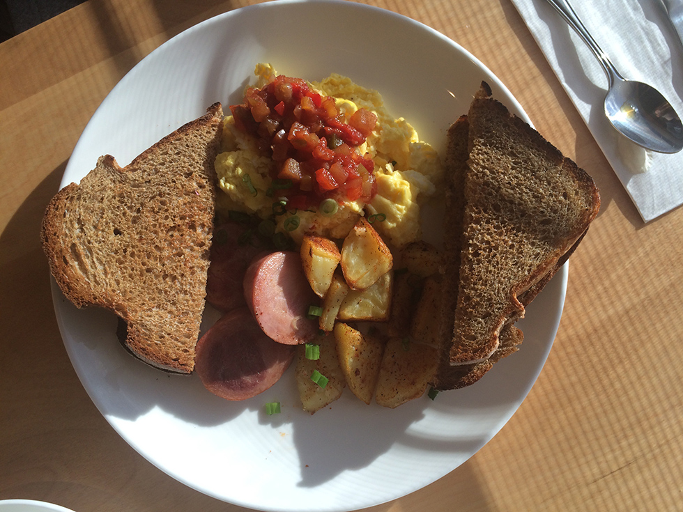 Aunt Sophies – 3 eggs scrammbled with cheddar cheese, fried kelbasa, potatoes, and sweet chili sauce- toast.