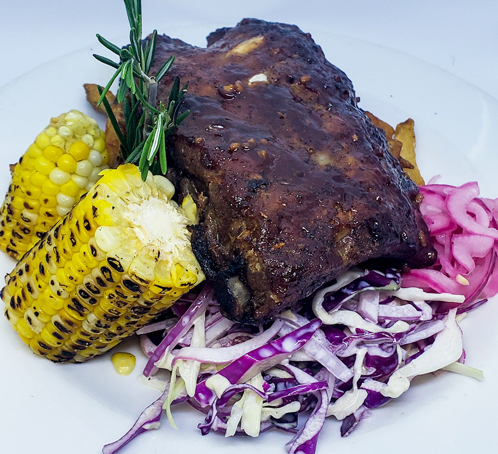 BBQ pork ribs, local corn and coleslaw.